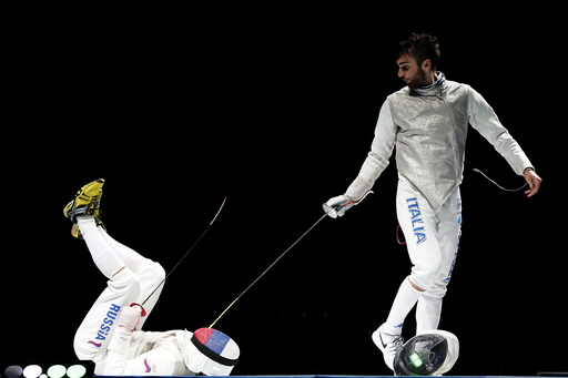 Russia's Rigin falls down as he competes against Italy's Garozzo during their men's team foil final at World Fencing Championships in Moscow