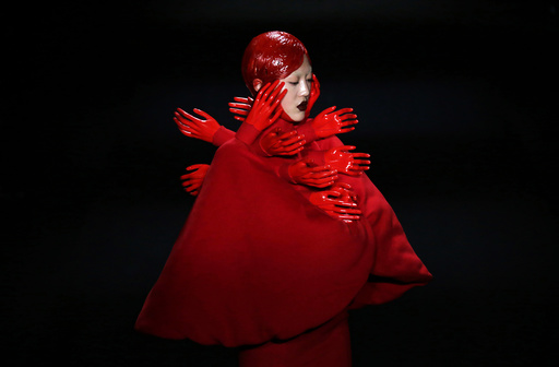 A model presents a creation by Chinese designer Hu Sheguang at China Fashion Week in Beijing