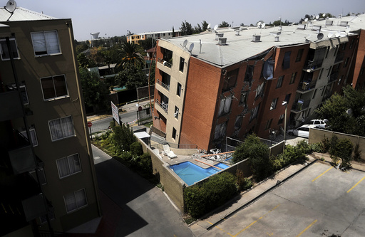 An apartment block leans over after an earthquake in Santiago