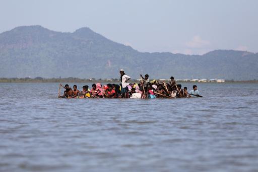Rohingya refugees cross the Naf River with an improvised raft to reach to Bangladesh at Sabrang near Teknaf