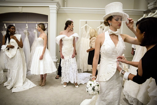 Models prepare for 11th annual toilet paper wedding dress contest at Kleinfled's Bridal Boutique in New York
