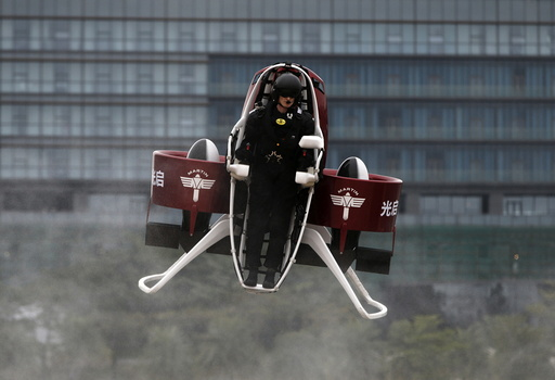Michael Read, director of Flight Operations from New Zealand-based Martin Aircraft Company, flies a Martin Jetpack during a demonstration at a water park in Shenzhen