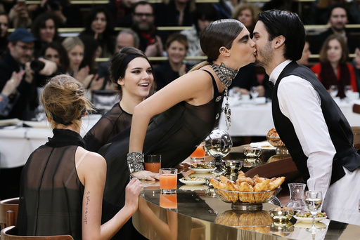 Model Delevingne kisses model Giabiconi as Jenner looks on during German designer Lagerfeld's Autumn/Winter 2015/2016 women's ready-to-wear collection for French fashion house Chanel during Paris Fashion Week