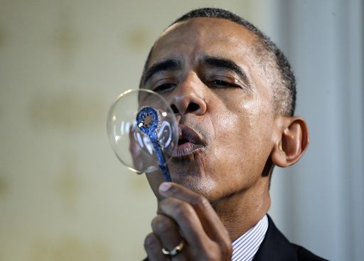 U.S. President Obama blows bubbles during the 2016 White House Science Fair in Washhington