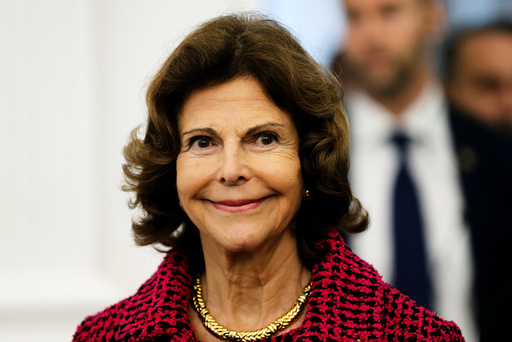 Sweden's Queen Silvia attends a ceremony at the city hall as part of a visit for the bicentenary of the Swedish throne in Pau