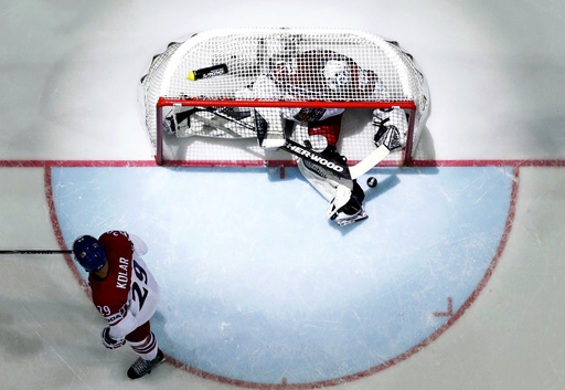 Goaltender Pavelec of the Czech Republic reacts after a goal during the Ice Hockey World Championship game against Canada at the O2 arena in Prague