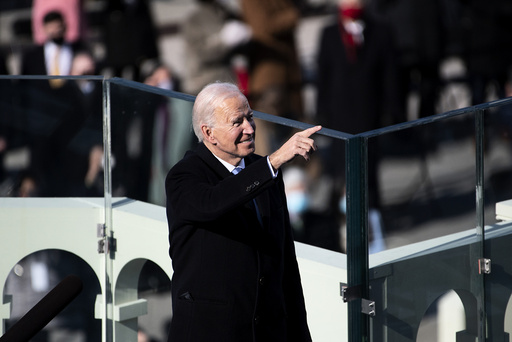 President Joe Biden points to guests after he is sworn in as the 46th President of the United States Wednesday, Jan. 20, 2021, at the U.S. Capitol in Washington. (Caroline Brehman/Pool Photo via AP)