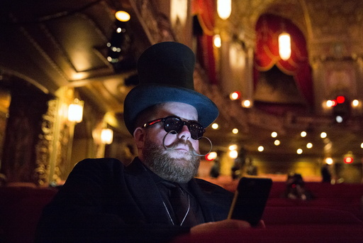Scott Miller from Chicago takes a break while participating in the 2015 Just For Men National Beard & Moustache Championships at the Kings Theater in the Brooklyn borough of New York