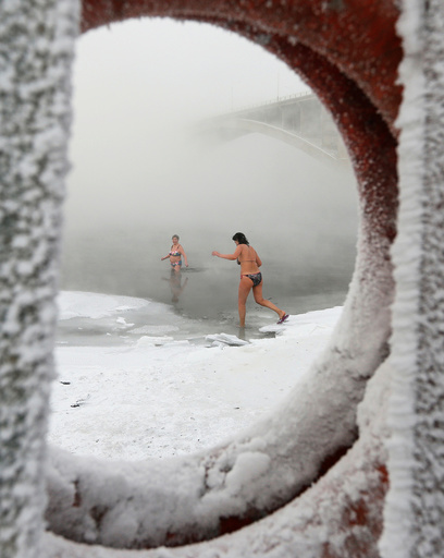 Members of the Cryophile winter swimmers club take a bath in the icy waters of the Yenisei River in Krasnoyarsk