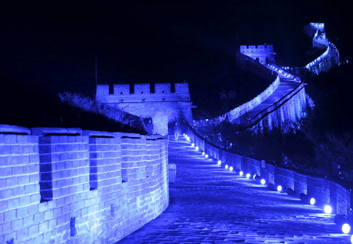 The Great Wall of China is lit up in blue to mark the 70th anniversary of the United Nations, in Beijing