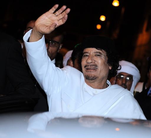 Libyan leader colonel Muammar Gaddafi walks in downtown Rome