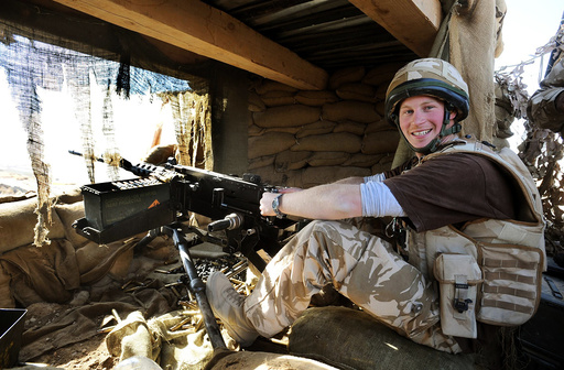 Britain's Prince Harry mans a 50 calibre machine gun, in Helmand province, southern Afghanistan