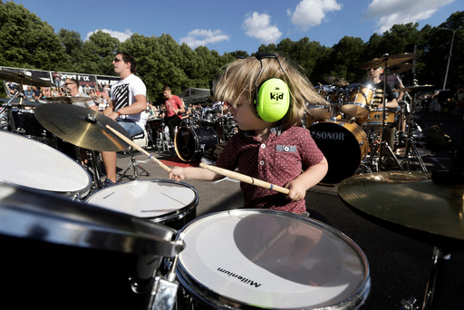 A boy together with more than 100 drummers performs during the Baltic Drummers' Summit in Riga