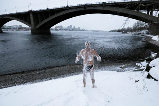Alexander Yaroshenko, a member of the Cryophile winter swimming club, rubs himself with snow after swimming in the Yenisei River in the Siberian city of Krasnoyarsk