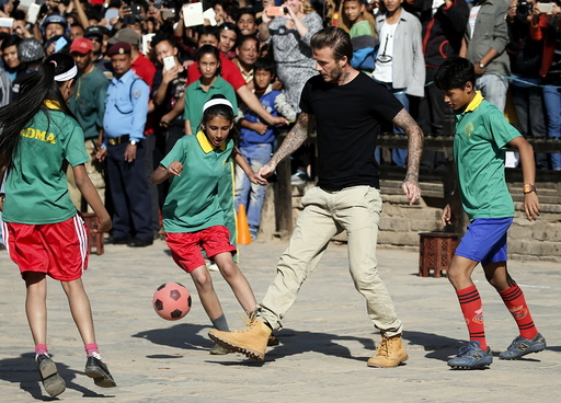 David Beckham kicks a ball during the charity match to collect funds for UNICEF at the ancient city of Bhaktapur