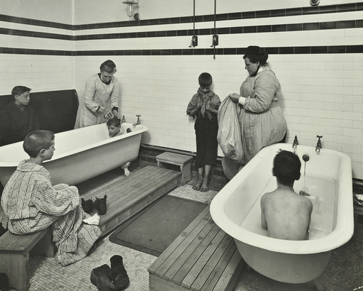 Attendants bathing boys at the Sun Court Cleansing Station, London, 1914. Artist: Unknown.