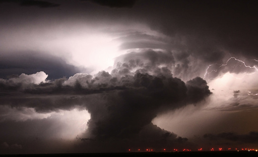 A supercell that became a Tornadic vortex signature lights up the night sky with lightning over Amarillo