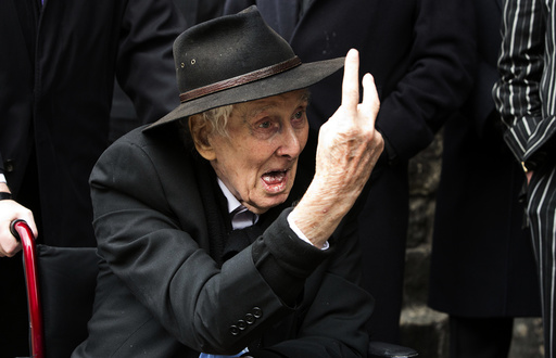 File photograph shows Great Train Robber Ronnie Biggs gesturing as he arrives for the funeral of Bruce Reynolds, at the church of St Bartholomew the Great in London
