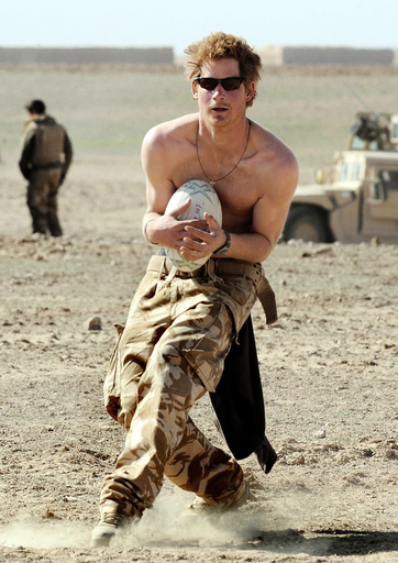 Britain's Prince Harry plays rugby during a break from duties, in Helmand province in Southern Afghanistan