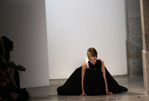 A model falls while presenting a creation by fashion designer Miguel Vieira as part of his Autumn/winter 2012 fashion collection during Lisbon Fashion Week