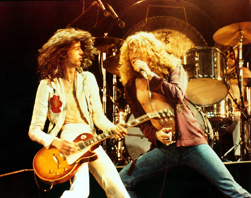 THE SONG REMAINS THE SAME, Led Zeppelin members Jimmy Page and Robert Plant, 1976