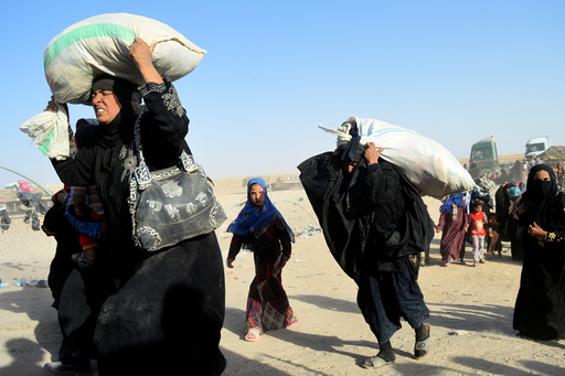 Women displaced by violence from Islamic State militants, arrive at a military base in Ramadi