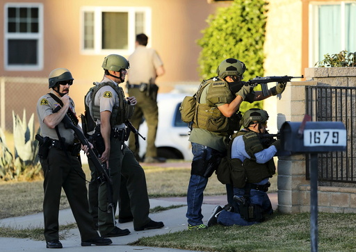 Police officers conduct a manhunt after a shooting rampage in San Bernardino