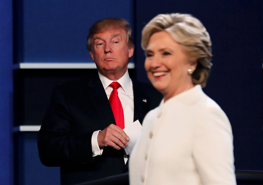 Republican U.S. presidential nominee Donald Trump and Democratic U.S. presidential nominee Hillary Clinton finish their third and final 2016 presidential campaign debate at UNLV in Las Vegas