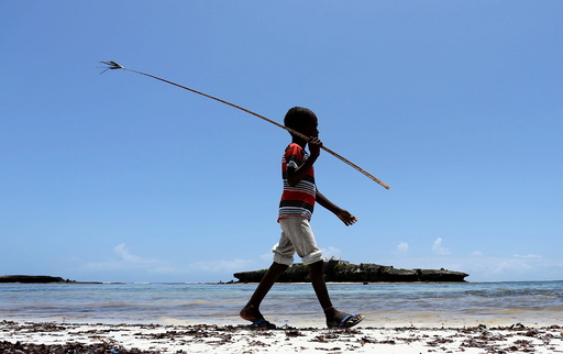 A boy walks along the Jazeera beach near Somalia's capital Mogadishu