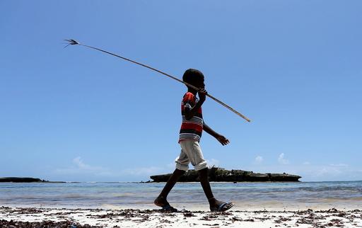 A boy walks along the Jazeera beach near Somalia's capital Mogadishu