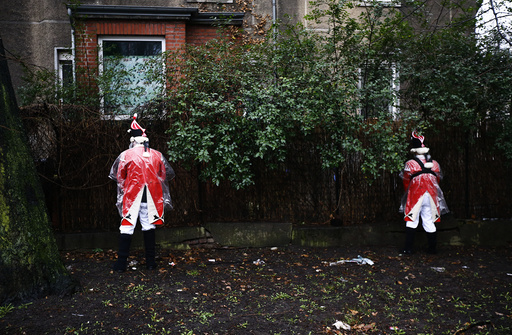 Carnival musicians urinate in bushes before taking take part in Rose Monday parade in Cologne