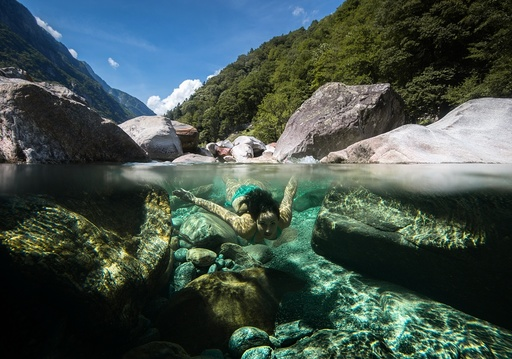 Summer bathing in Swiss Verzasca river
