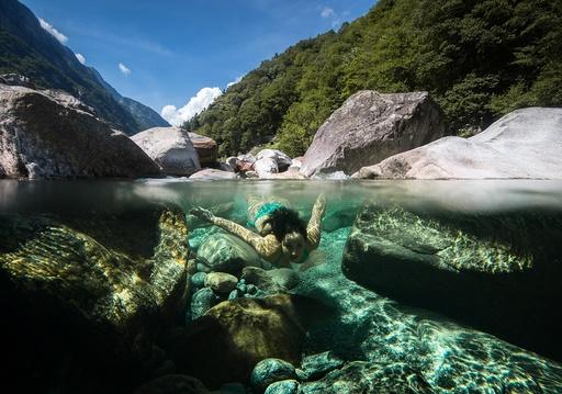 Summer bathing in Swiss Verzasca river