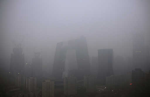 The China Central Television (CCTV) building and the Central Business District area are seen amid heavy smog after the city issued its first ever