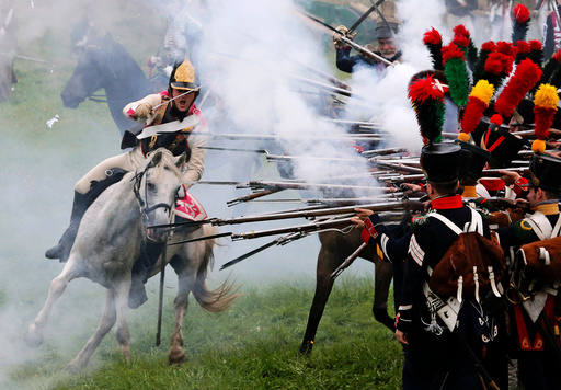 Participants reenact the 1812 Battle of Borodino between Russia and the invading French army during anniversary celebrations in Moscow region