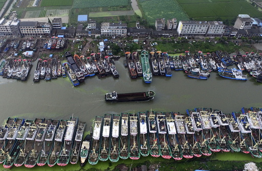 An aerial view shows boats being anchored in a bay as Typhoon Chan-Hom approaches Taizhou