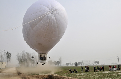 A home-made airship, made by 29-year-old local man Shi Songbo, lifts off during a test flight next to crop fields in Ningling county of Shangqiu