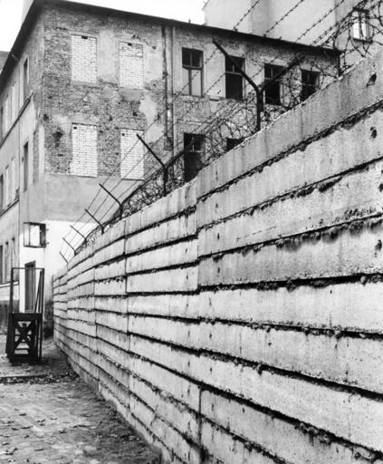 Berlin Wall with border house in Bernauer Street in Berlin