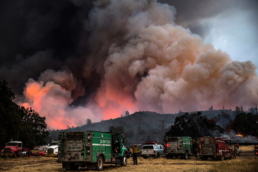 Firefighters watch the Rocky Fire advance in Lake County, California