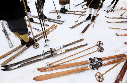 Participants on vintage skis prepare for a traditional historical ski race in the northern Bohemian town of Smrzovka