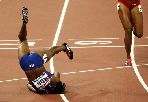 Tiffany Porter of Britain falls after competing in the women's 100 metres hurdles final during the 15th IAAF World Championships at the National Stadium in Beijing