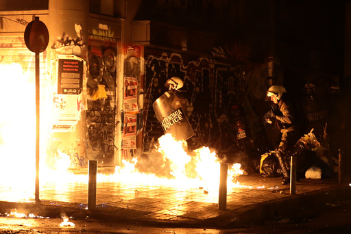 A petrol bomb explodes next to riot police during a demonstration against the visit of US President Obama in Athens