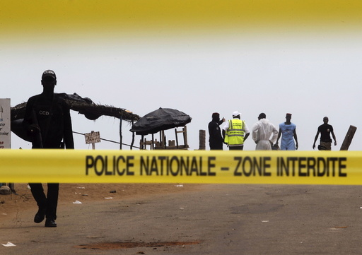 A police cordon is seen while Ivorian police prepare to inspect the area of the hotel Etoile du Sud following an attack by gunmen from al Qaeda's North African branch, in Grand Bassam