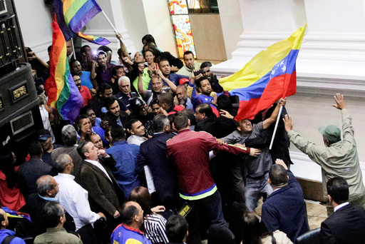 Supporters of Venezuela's President Nicolas Maduro storm into a session of the National Assembly in Caracas