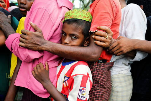 A Rohingya refugee boy stands in a queue to collect relief supplies after being affected by Cyclone Mora in Coxâä™s Bazar