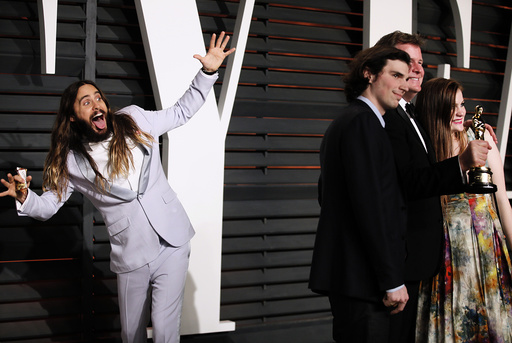 Jared Leto photobombs James W. Skotchdopole at the 2015 Vanity Fair Oscar Party in Beverly Hills