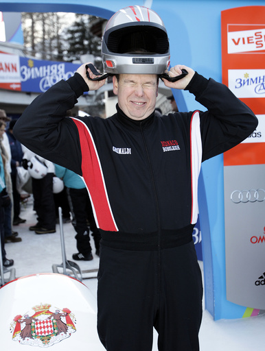 Prince Albert II of Monaco adjusts his helmet before the start of the Bobsleigh Monaco Historic race at the Olympia Run in St. Moritz