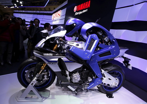 Yamaha Motor Co Ltd's displays the company's prototype model of a motorcycle riding robot 'MOTOBOT Ver. 1' at the 44th Tokyo Motor Show in Tokyo, Japan