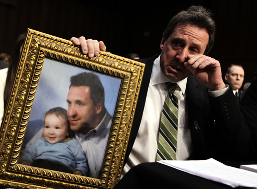 Neil Heslin, father of 6-year-old Newtown victim Jesse Lewis, cries during Senate Judiciary Committee hearing on Assault Weapons Ban of 2013 in Washington