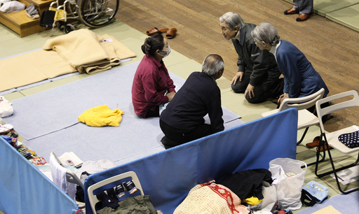 Emperor Akihito and Empress Michiko talk with evacuees from the March 11 earthquake and tsunami, at Tokyo Budoh-kan, currently an evacuation shelter, in Tokyo